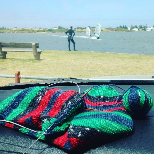 Knitting my LOOOOONG sailersocks while watching DH have a gohellip